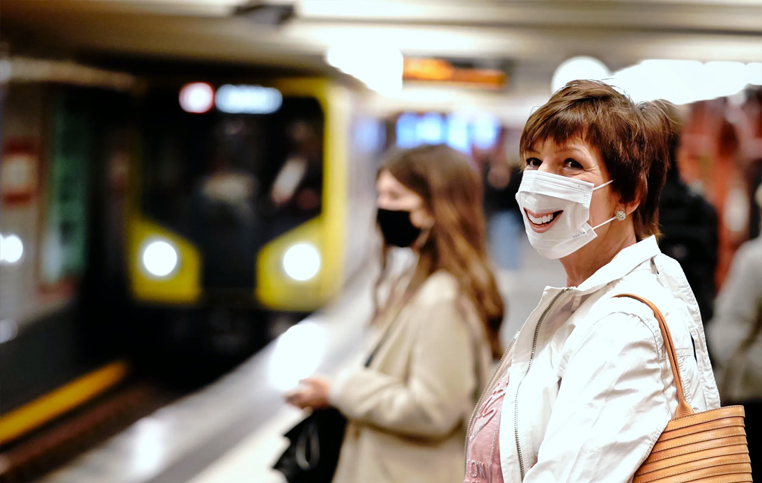 Passengers with face masks wait for a train at the Alexanderplatz underground station in Berlin, Germany