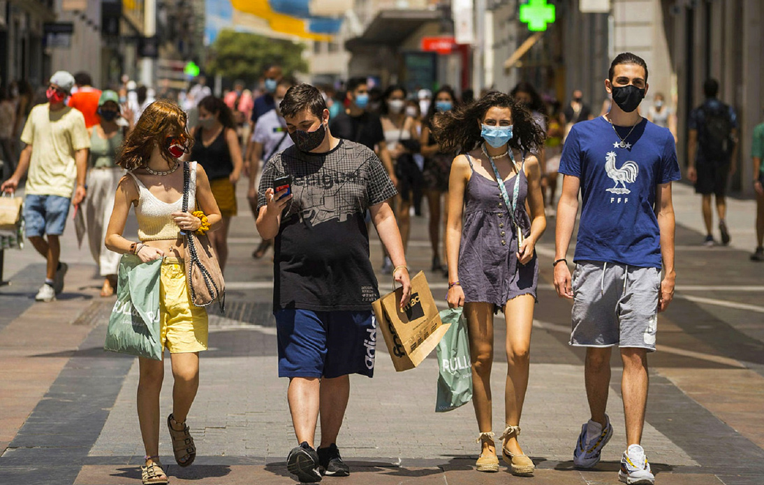 People wearing a mask on the street in Madrid, Spain