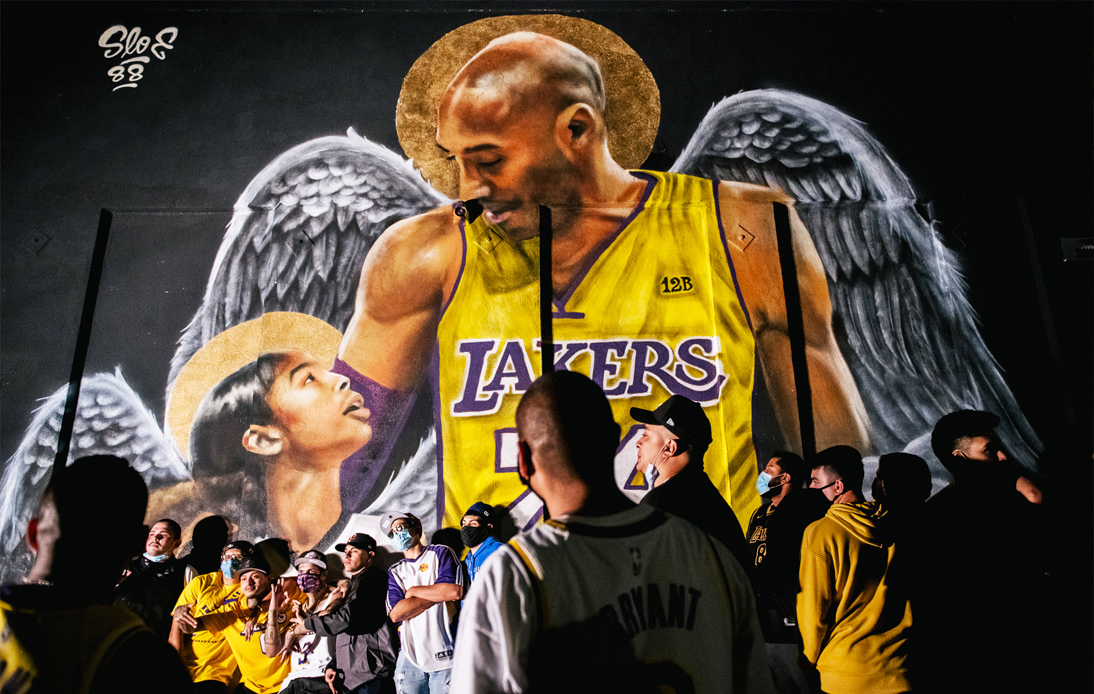 The Lakers fans celebrate winning with Kobe Bryant